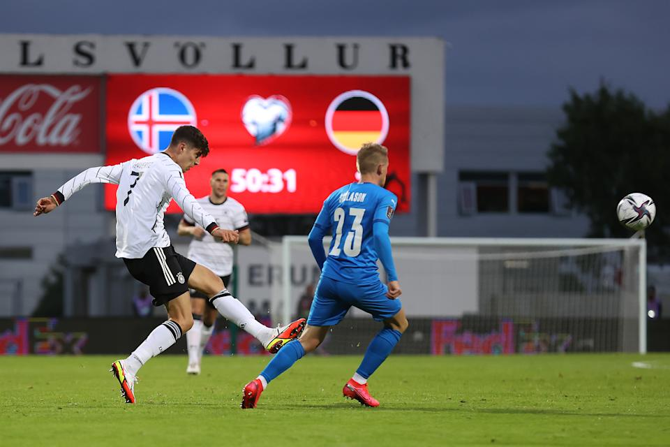 REYKJAVIK, ICELAND - SEPTEMBER 08: Kai Havertz of Germany is challenged by Ari Skulason of Iceland during the 2022 FIFA World Cup Qualifier match between Iceland and Germany at Laugardalsvollur National on September 08, 2021 in Reykjavik, Iceland. (Photo by Alex Grimm/Getty Images)