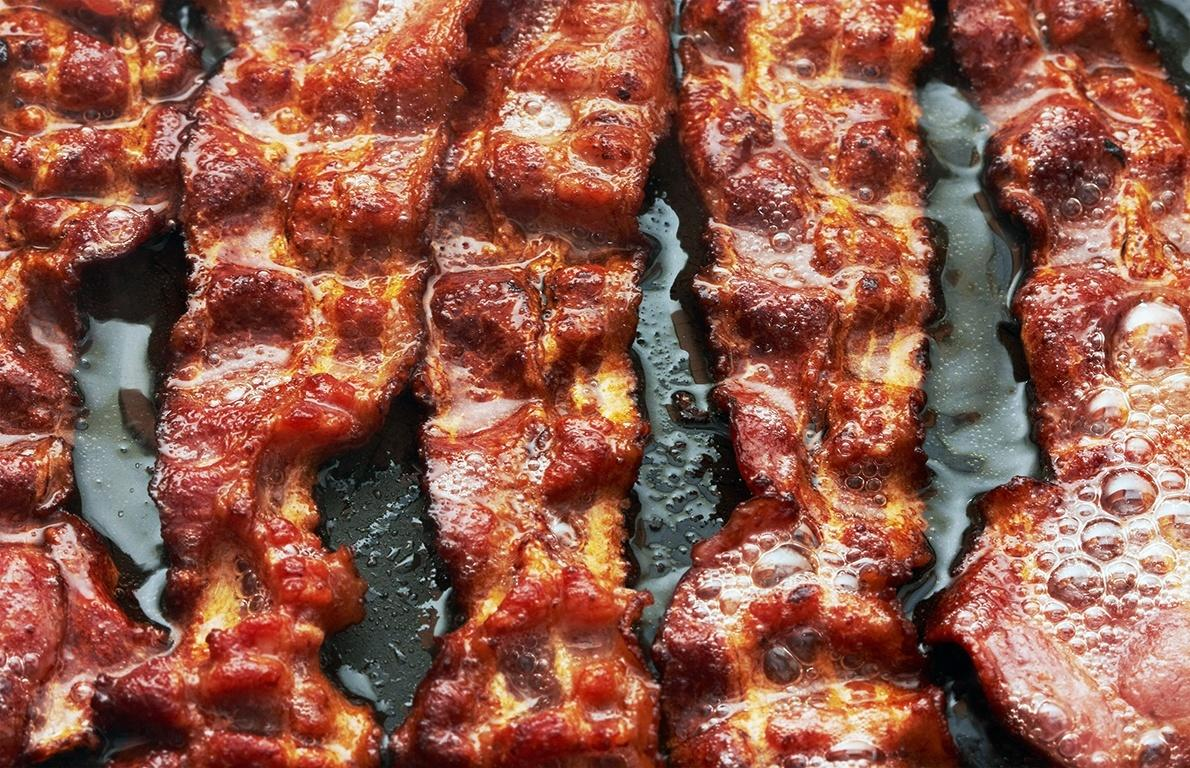 "<p>Bacon is a preserved pork product (usually taken from the pig's fatty belly), that's either cured in a brine or dry-packed with salt and spices, and then smoked. <a href=""http://www.thedailymeal.com/travel/12-ways-bacon-eaten-around-world""><b>Bacon is versatile and delicious</b></a>, but it should be used as a flavoring agent because of its high sodium content. One ounce of bacon contains around 400 milligrams of sodium, a little less than 20 percent of your recommended daily allowance. Pair it with <a href=""http://www.thedailymeal.com/cook/breakfast""><b>eggs, home fries, and toast,</b></a> and you're looking at a super salty breakfast.</p>"