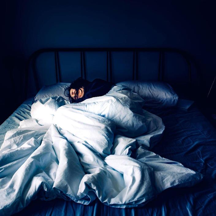 woman sleeping in a comfy bed