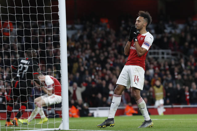 Arsenal's Pierre-Emerick Aubameyang, right, reacts after a missed scoring opportunity during the Europa League round of 16, 2nd leg, soccer match between Arsenal and Rennes at the Emirates stadium in London, Thursday, March 14, 2019. (AP Photo/Alastair Grant)