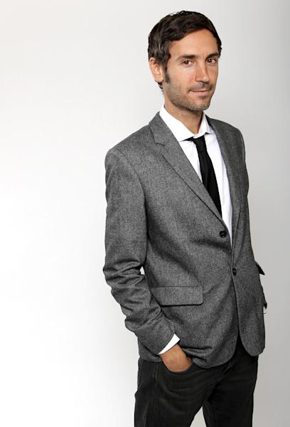 """FILE - This Feb. 4, 2013 file photo shows director Malik Bendjelloul posing for a portrait at the 2013 Oscar Nominee Luncheon in Los Angeles. Police in Sweden say Malik Bendjelloul the film director behind the Oscar-awarded music documentary """"Searching for Sugarman,"""" has died. He was 36. Police spokeswoman Pia Glenvik said Bendjelloul died in Stockholm late Tuesday, May 13, 2014, but wouldn't specify the cause of death. (Photo by Matt Sayles/Invision/AP, File)"""