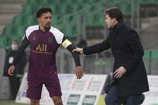 PSG's head coach Mauricio Pochettino speaks with PSG's Marquinhos during the French League One soccer match between Saint-Etienne and Paris Saint-Germain at the Geoffroy Guichard stadium, in Saint-Etienne, central France, Wednesday, Jan. 6, 2021. (AP Photo/Laurent Cipriani)