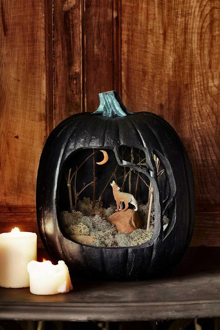 """<p>Create your own mini landscape inside a pumpkin with styrofoam, twigs, and miniature figurines.</p><p><em>Get the tutorial from <a href=""""https://www.countryliving.com/diy-crafts/g1189/best-halloween-crafts-ever/?slide=64"""" rel=""""nofollow noopener"""" target=""""_blank"""" data-ylk=""""slk:Country Living"""" class=""""link rapid-noclick-resp"""">Country Living</a>.</em><br></p>"""