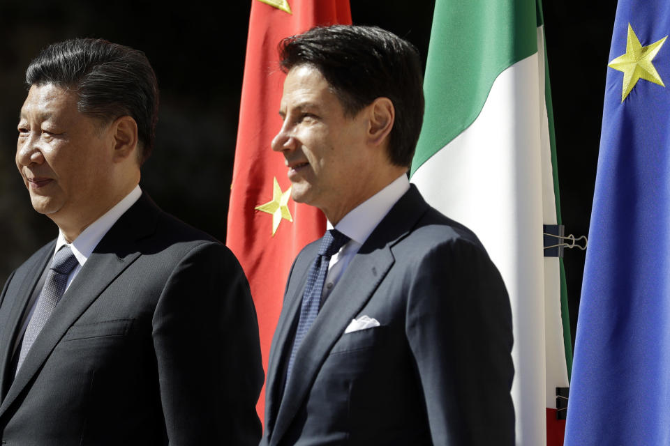 Chinese President Xi Jinping, left, and Italian Premier Giuseppe Conte pose for photographers during their meeting at Rome's Villa Madama, Saturday, March 23, 2019. (AP Photo/Andrew Medichini)