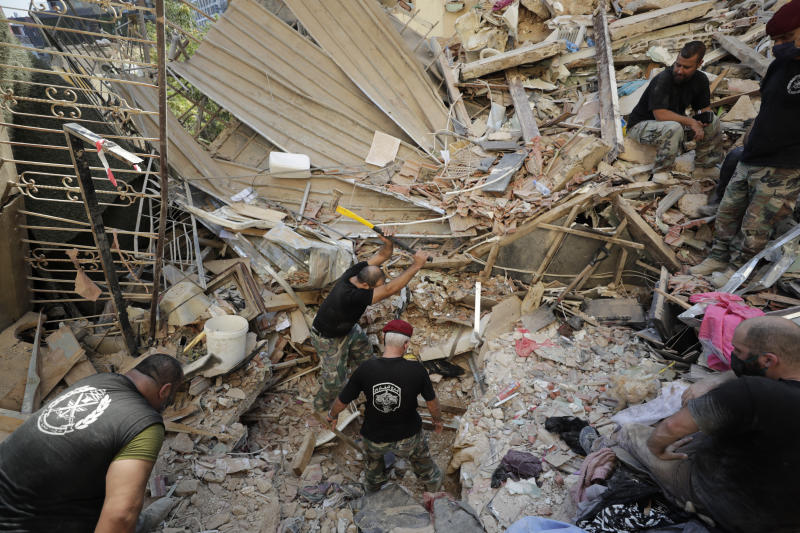 Lebanese soldiers search for survivors after a massive explosion in Beirut, Lebanon, Wednesday, Aug. 5, 2020. The explosion flattened much of a port and damaged buildings across Beirut, sending a giant mushroom cloud into the sky. In addition to those who died, more than 3,000 other people were injured, with bodies buried in the rubble, officials said.(AP Photo/Hassan Ammar)