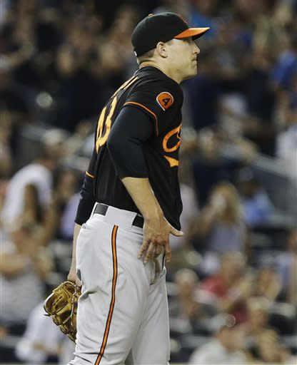 Baltimore Orioles' Jim Johnson reacts after walking in a run during the ninth inning of a baseball game against the New York Yankees, Friday, July 5, 2013, in New York. The Yankees won the game 3-2. (AP Photo/Frank Franklin II)