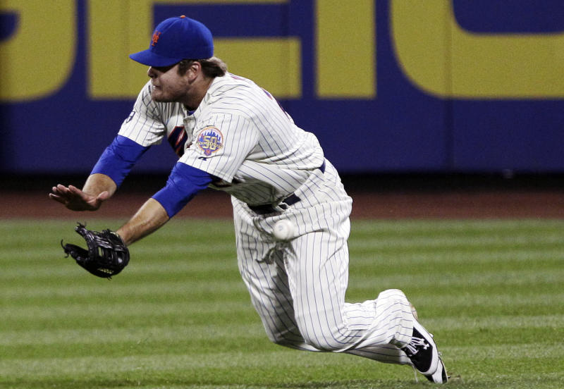New York Mets right fielder Lucas Duda dives to catch a ball hit by New York Yankees' Nick Swisher during the seventh inning of an interleague baseball game on Saturday, June 23, 2012, in New York. Duda missed the catch. (AP Photo/Frank Franklin II)