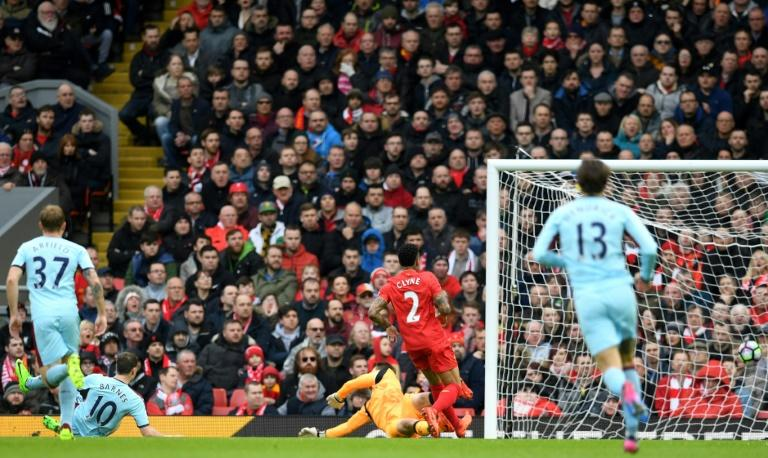 Burnley's striker Ashley Barnes (2nd L) watches as his shot hits the back of the Liverpool net for the opening goal of the English Premier League football match between Liverpool and Burnley on March 12, 2017