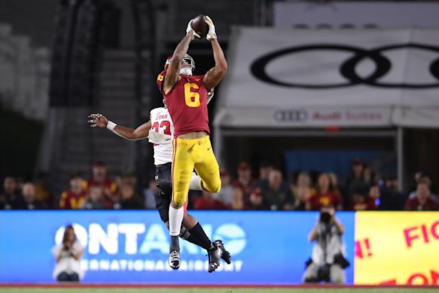 USC wide receiver Michael Pittman Jr. catches a deep jump ball over Utah defensive back Julian Blackmon for a touchdown on Sept. 20, 2019. They will be Indianapolis Colts teammates. (Photo by Peter Joneleit/Icon Sportswire via Getty Images)