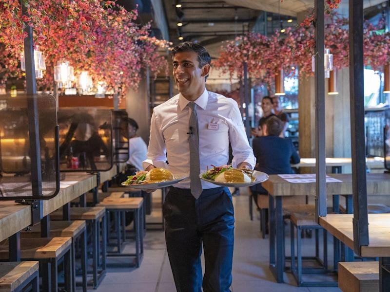 Chancellor Rishi Sunak serves food to customers in Wagamama, after announcing meal discounts for restaurant patrons in a bid to help the industry recover from the coronavirus crisis: Rishi Sunak