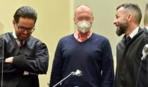 German sports doctor Mark S., accused of masterminding an international doping network in cycling and winter sports, speaks with his lawyers Alexander Dann and Yuri Goldstein as he waits for the verdict in his trial at the Regional Court in Munich