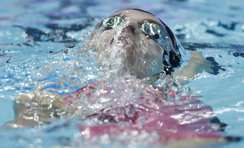 FILE - In this July 28, 2019 file photo, United States' Regan Smith swims the backstroke leg in the women's 4x100m medley relay final at the World Swimming Championships in Gwangju, South Korea. On Monday, March 30, 2020, the Tokyo Games were pushed back a full year by the coronavirus pandemic, to the same period of the biannual aquatics, causing the swimming's governing body to go back to the drawing board to figure out when to hold its next world championships. (AP Photo/Lee Jin-man, file)
