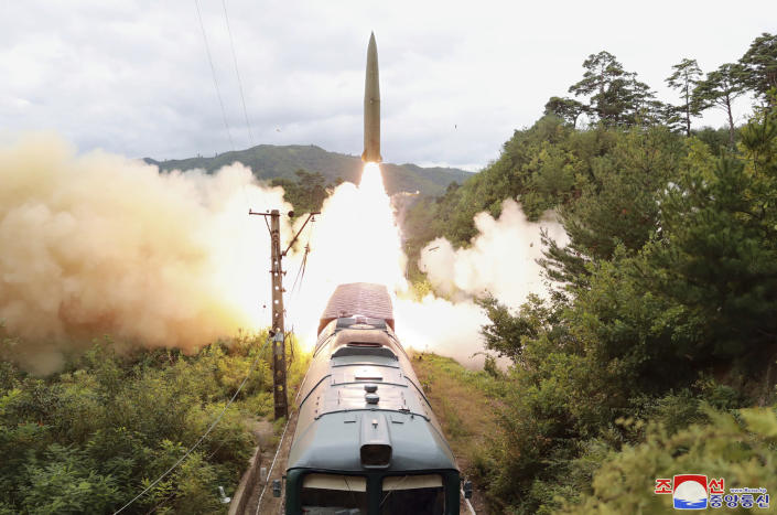 """FILE - In this Sept. 15, 2021 file photo provided by the North Korean government shows a missile test firing launched from a train at an undisclosed location of North Korea. North Korea's recent sword-rattling after months of relative quiet makes clear that leader Kim Jong Un is working on expanding his weapons arsenal. Independent journalists were not given access to cover the event depicted in this image distributed by the North Korean government. The content of this image is as provided and cannot be independently verified. Korean language watermark on image as provided by source reads: """"KCNA"""" which is the abbreviation for Korean Central News Agency. (Korean Central News Agency/Korea News Service via AP)"""