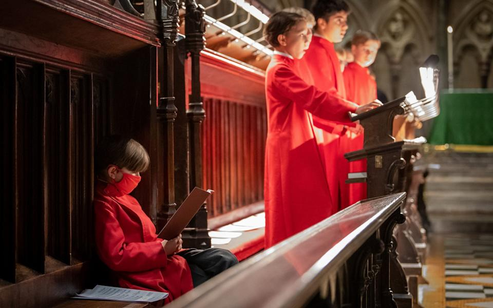 The Choir of St John's College, Cambridge as they rehearse ahead of evensong in St John's College Chapel, which fell silent for 207 days during the coronavirus lockdown - PA