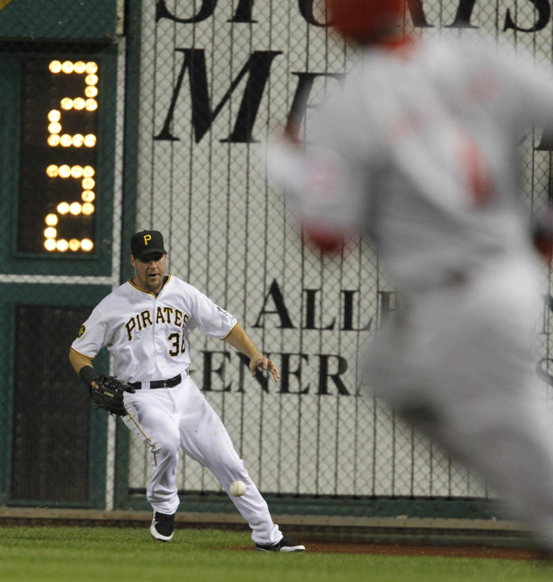 Cincinnati Reds' Brandon Phillips, right, heads towards second as Pittsburgh Pirates right fielder Ryan Ludwick fields the bouncing ball in the third inning of the baseball game on Saturday, Sept. 24, 2011, in Pittsburgh.  Phillips got a double on the hit. (AP Photo/Keith Srakocic)