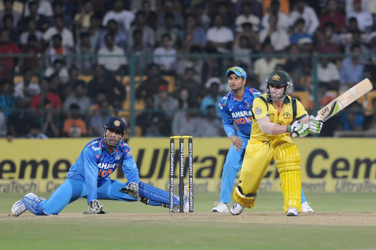Australian player Phillip Hughes in action during the 7th ODI between India and Australia played at Chinnaswamy Stadium in Bangalore on Nov.2, 2013. (Photo: IANS)