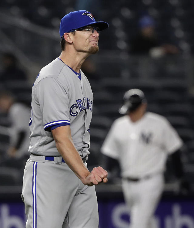 Toronto Blue Jays pitcher Tyler Clippard reacts after giving up a solo home run to New York Yankees' Aaron Judge during the seventh inning of a baseball game Thursday, April 19, 2018, in New York. (AP Photo/Julie Jacobson)