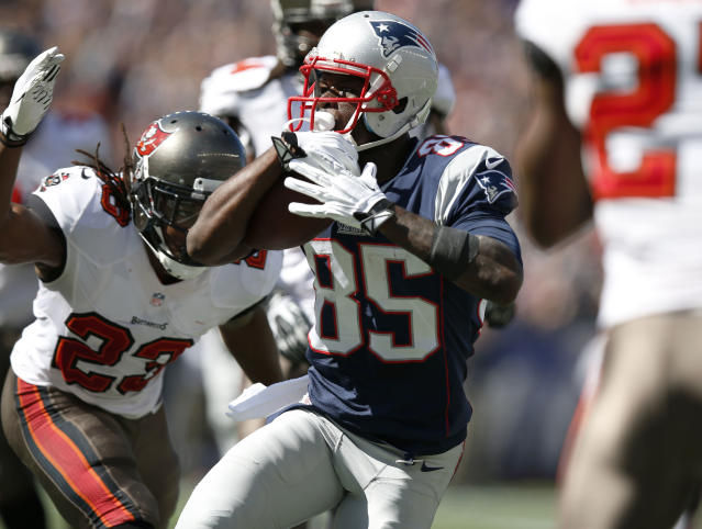New England Patriots wide receiver Kenbrell Thompkins (85) runs past Tampa Bay Buccaneers strong safety Mark Barron (23) for a touchdown after catching a Tom Brady pass the in the first half of an NFL football game Sunday, Sept. 22, 2013, in Foxborough, Mass. (AP Photo/Elise Amendola)