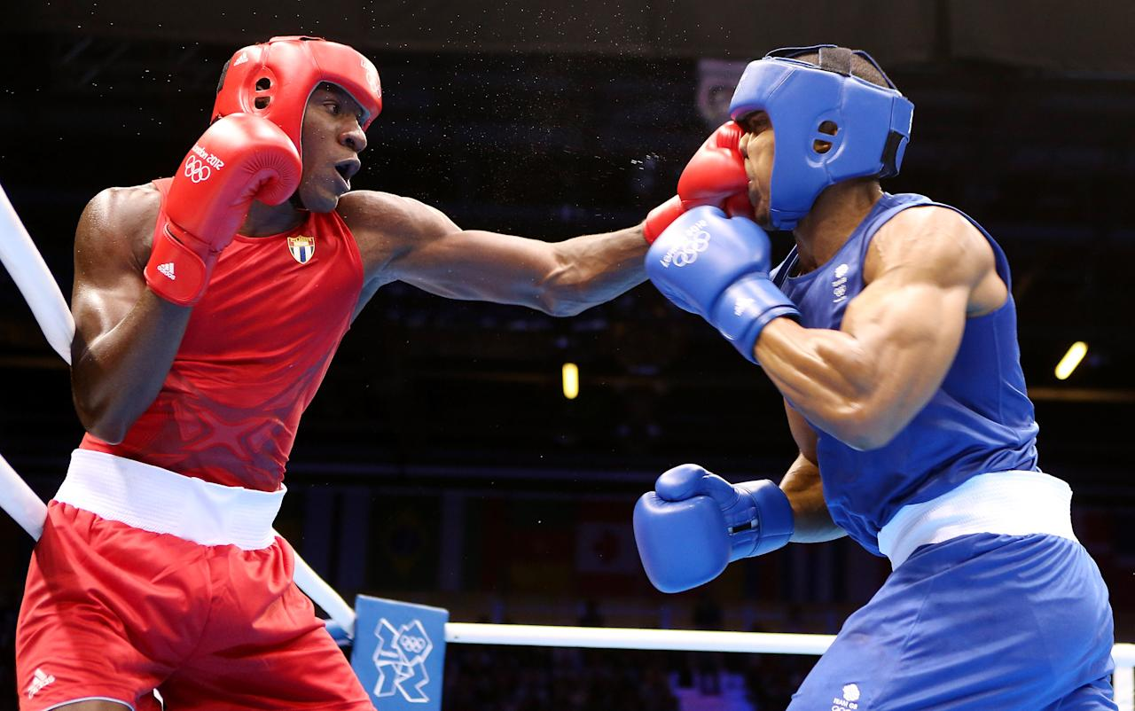 LONDON, ENGLAND - AUGUST 01:  Anthony Joshua of Great Britain (R) in action with Erislandy Savon Cotilla of Cuba during the Men's Super Heavy ( 91kg) Boxing on Day 5 of the London 2012 Olympic Games at ExCeL on August 1, 2012 in London, England.  (Photo by Scott Heavey/Getty Images)
