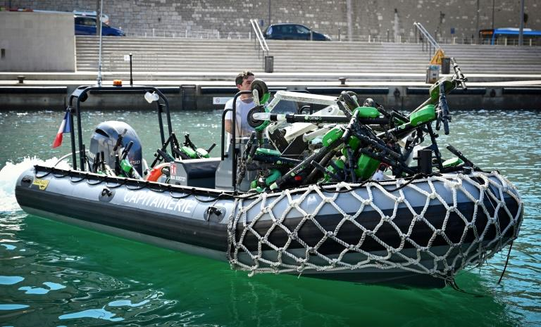 A raft with electric scooters recovered in July from the sea near Marseille, one of several French cities grappling with e-scooter vandalism (AFP Photo/GERARD JULIEN)