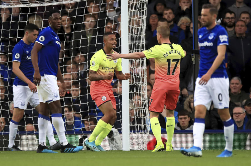 Manchester City's Gabriel Jesus, centre, celebrates scoring his side's first goal of the game against Everton during their English Premier League soccer match at Goodison Park in Liverpool, England, Saturday Sept. 28, 2019. (Peter Byrne/PA via AP)