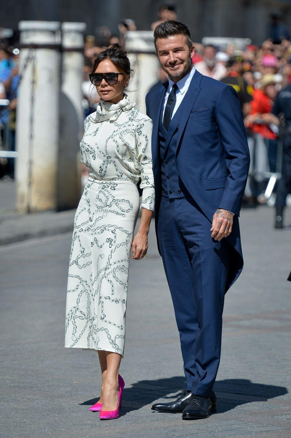 <p>Over the years, Victoria and David Beckham have proved that no other duo does a couple dressing quite as well. They always look brilliant, but especially so here at footballer Sergio Ramos' wedding to Pilar Rubio. These bright fuchsia heels are *chef's kiss*. </p>