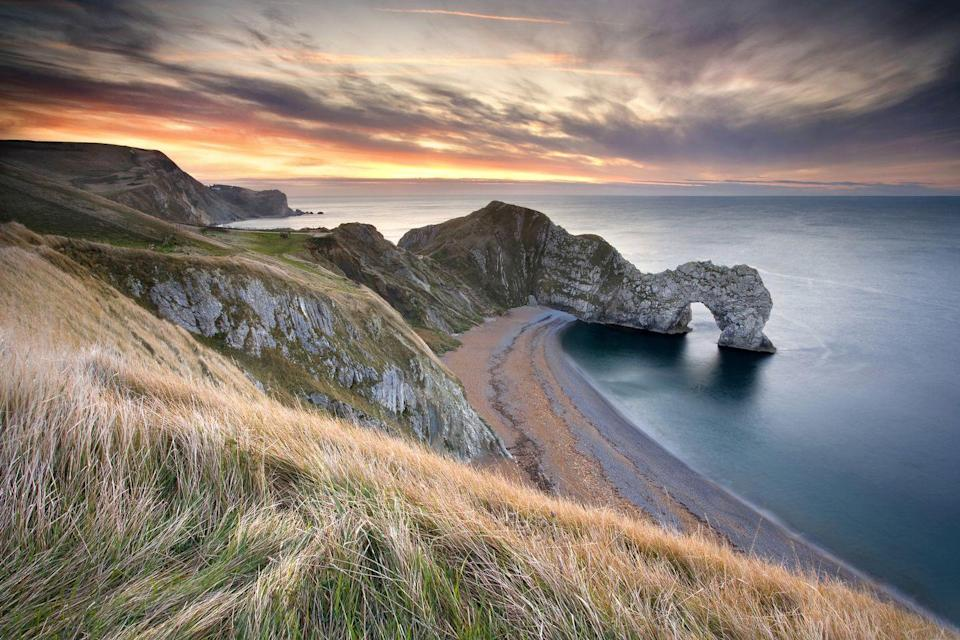 """<p>The Jurassic Coast is a 95-mile long World Heritage Site stretching from Exmouth in East Devon to Studland Bay in Dorset. One of the most breathtakingly beautiful sections is the natural limestone arch and beach at Durdle Door. </p><p>Catch epic sunsets and sunrises and, around two weeks either side of the winter solstice, you can even see the sun emerging on the horizon right through the arch. Don't forget to take the 2km walk along the cliffs to another epic UK winter beach, Lulworth Cove.</p><p>Where to stay: Drop your bags off look forward to a spot of luxury at the <a href=""""https://www.countrylivingholidays.com/offers/dorset-summer-lodge-hotel"""" rel=""""nofollow noopener"""" target=""""_blank"""" data-ylk=""""slk:Summer Lodge Country Hotel"""" class=""""link rapid-noclick-resp"""">Summer Lodge Country Hotel</a>, around a 40-minute drive inland.</p><p><strong>Country Living readers can enjoy an exclusive offer, and save up to 35% on a two-night stay, including dinner on one night, breakfast for both days, complimentary hand-made chocolates and a guided tour of Evershot with a local history expert.</strong></p><p><a class=""""link rapid-noclick-resp"""" href=""""https://www.countrylivingholidays.com/offers/dorset-summer-lodge-hotel"""" rel=""""nofollow noopener"""" target=""""_blank"""" data-ylk=""""slk:CHECK AVAILABILITY"""">CHECK AVAILABILITY</a><br></p>"""
