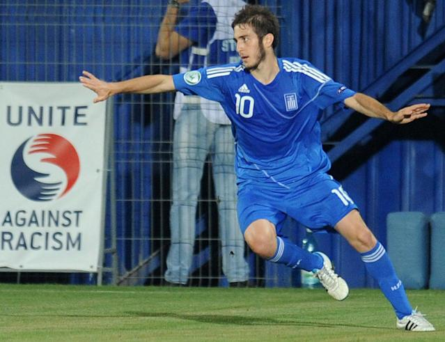 Kostas Fortunis of Greece celebrates after he scored 1-0 against Romania during the football final tournament of UEFA European Under-19 Championship 2010/2011 in Berceni village next to Bucharest July 23, 2011. AFP PHOTO/DANIEL MIHAILESCU (Photo credit should read DANIEL MIHAILESCU/AFP/Getty Images)