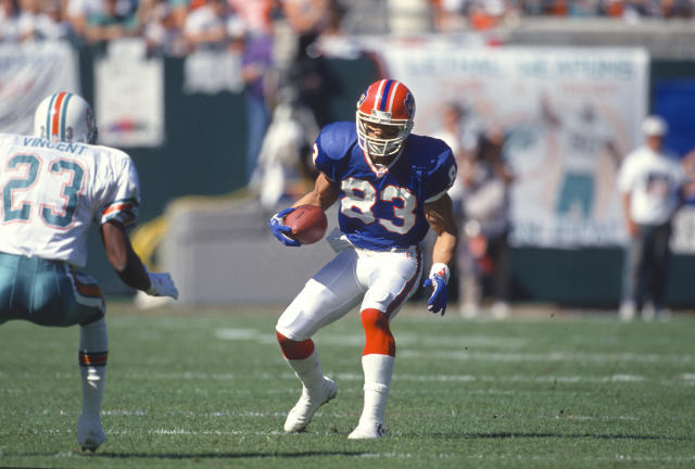 The Bills have been able to keep their colors clean and classic like they were here with Andre Reed. (Photo by Focus on Sport/Getty Images)