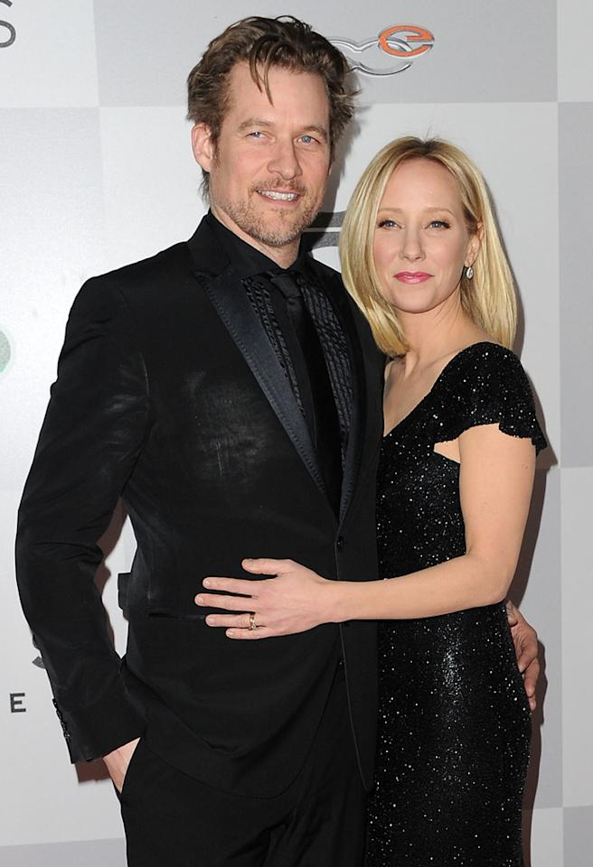 BEVERLY HILLS, CA - JANUARY 13:  Actor James Tupper (L) and actress Anne Heche arrive at the NBC Universal's 70th annual Golden Globe Awards after party  on January 13, 2013 in Beverly Hills, California.  (Photo by Allen Berezovsky/Getty Images)