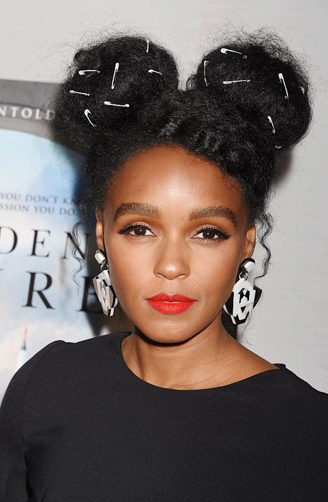 Monae is committed to the black and white and pins look. (Photo: Getty Images)