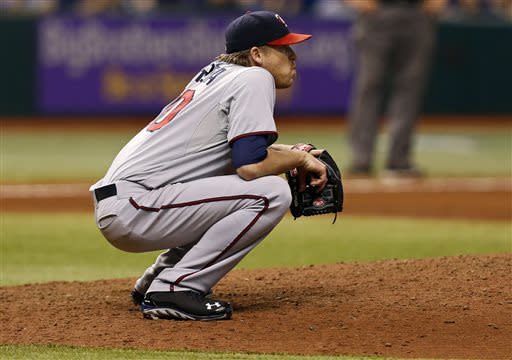 Minnesota Twins starting pitcher Kevin Correia watches a two-run home run hit by Tampa Bay Rays' Kelly Johnson during the sixth inning of a baseball game on Wednesday, July 10, 2013, in St. Petersburg, Fla. (AP Photo/Mike Carlson)