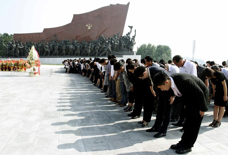 North Koreans bow in front of a statue of Kim Il Sung on the 18th anniversary of the late North Korea founder's death on Sunday, July 8, 2012, at Mansu Hill in Pyongyang, North Korea. (AP Photo/Kim Kwang Hyon)