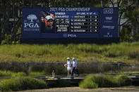 Louis Oosthuizen, of South Africa, walks with his caddie on the bridge to the 13th hole during the second round of the PGA Championship golf tournament on the Ocean Course Friday, May 21, 2021, in Kiawah Island, S.C. (AP Photo/David J. Phillip)