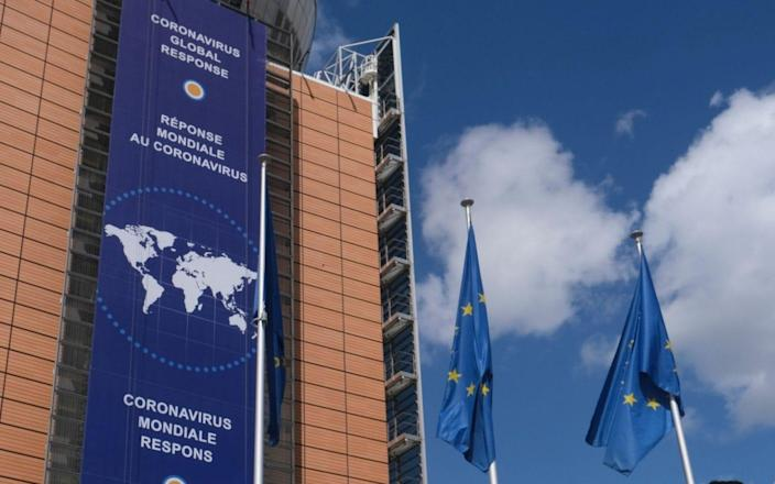 A banner highlighting the coronavirus global response in front of the European Commission headquarters in Brussels - OLIVIER HOSLET/EPA-EFE/Shutterstock