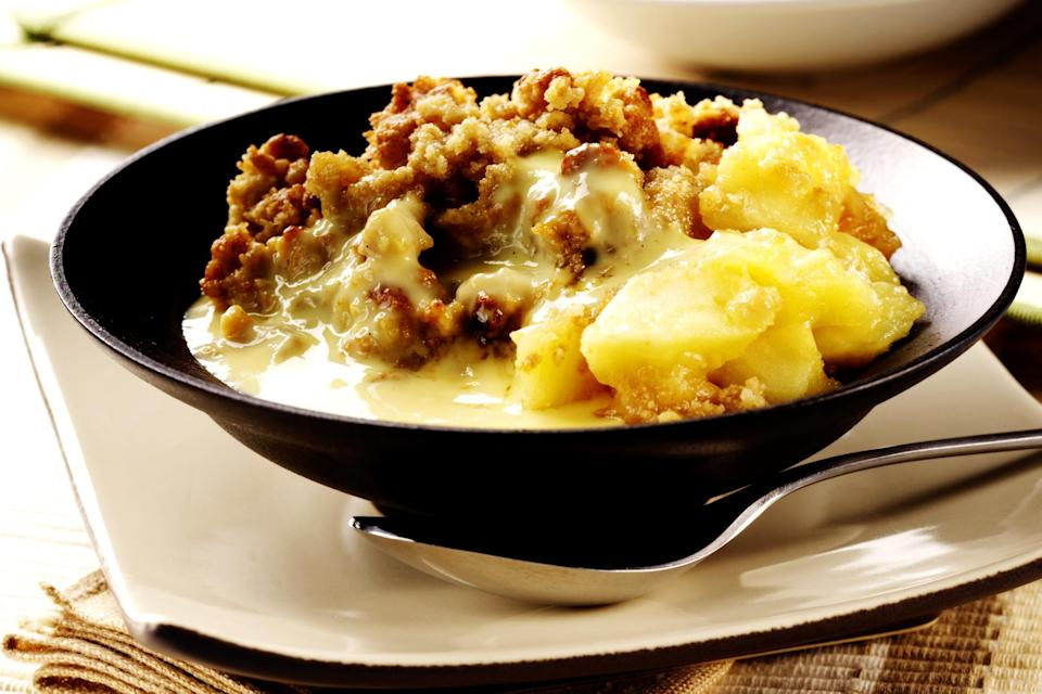 """<p>Nothing says winter warmer quite like a bowl of crumble and custard. Whether you use the autumn apples you prepped and froze or more seasonal fruits. Here are <a rel=""""nofollow noopener"""" href=""""http://www.countrylife.co.uk/food-drink/top-five-best-crumble-recipes-autumn-63045"""" target=""""_blank"""" data-ylk=""""slk:five crumble recipes from Country Life"""" class=""""link rapid-noclick-resp"""">five crumble recipes from Country Life</a>. [Photo: Getty] </p>"""