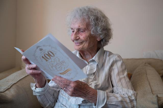 Great-great grandmother Doris Cleife reads birthday cards in her flat. (PA Images)