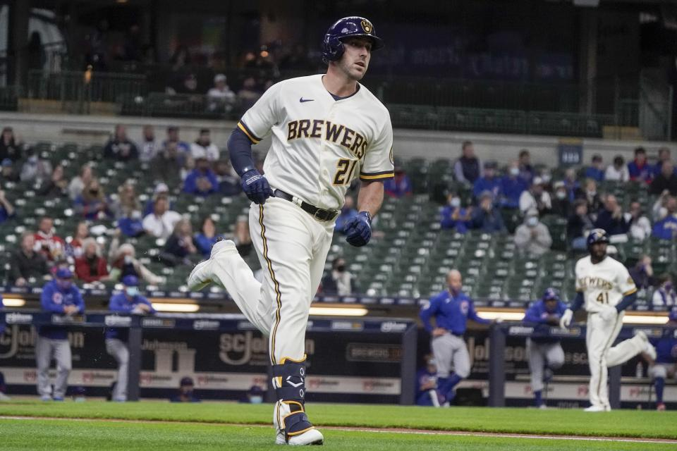 Milwaukee Brewers' Travis Shaw hits an RBI single during the first inning of a baseball game against the Chicago Cubs Wednesday, April 14, 2021, in Milwaukee. (AP Photo/Morry Gash)