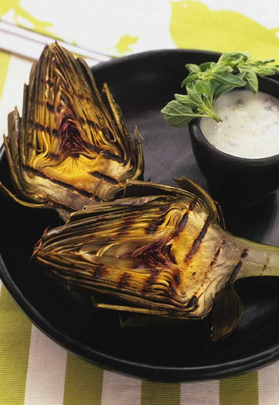 """<p>Who knew artichokes could look so scrumptious? Everyone will know you did when this tray is carried into the room. </p><p><strong><a href=""""https://www.countryliving.com/food-drinks/recipes/a1216/grilled-artichokes-creamy-butter-dip-3322/"""" rel=""""nofollow noopener"""" target=""""_blank"""" data-ylk=""""slk:Get the recipe"""" class=""""link rapid-noclick-resp"""">Get the recipe</a>.</strong></p>"""