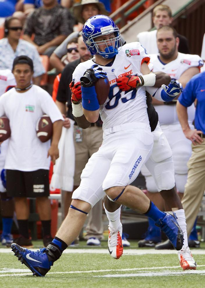 Boise State tight end Holden Huff (85) gets tackled by Oregon State safety Ryan Murphy, back, after catching a pass in the second quarter of the Hawaii Bowl NCAA college football game, in Honolulu, Tuesday, Dec. 24, 2013. (AP Photo/Eugene Tanner)