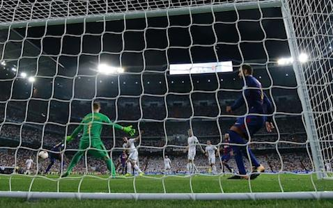 Real Madrid (5) 2 (Asensio 4', Benzema 38') - 0 (1) Barcelona Is there a team in world football who could beat this Real Madrid side? Zinedine Zidaneexpanded on his incredible record as amanager on Wednesday night as he won his second trophy of the 2017/18 season,before the Spanish league has even begun. The suspended Cristiano Ronaldo wasn't needed, nor even worthy of mentionin the end, as Real Madrid saw off their arch rivals easily, doing so without several key players in a match which will leave Ernesto Valverde along with the Barcelona board, players and fans, worried about what they can realistically hope to achieve this season. Real Madrid are an absolute monster under Zidane and rested Gareth Bale, Casemiro and Isco for this second leg - the latter was the best player on the pitch at the Nou Camp - and Barcelona had no answer to their quick passing, high tempo pressing and slick movement. Their dreadful start certainly didn't help. Real Madrid began the first half pressing high and hard, showing a desire and energy to win the ball - and keep it - that Barcelona just couldn't match. Samuel Umtiti was forced back towards his own goal from kick-off and any attempts to play out from the back were closed down quickly and with purpose. Credit: GETTY IMAGES Valverde's decision to abandon the usual Barcelona 4-3-3 was an attempt to deal with the giant Neymar shaped hole that has been left on the left wing but his decision to start with a 5-3-2 was surprising. A confused, nervous display in the first half may have revealedhow little time they have spent working on the system during a packed pre-season. It soon unraveled. And if you replace the word 'soon' with 'immediately', you might get a better feel for just how woefully unprepared Barcelona looked for this. Real, by contrast, were buzzing from the first whistle. Marco Asensio, Zidane's bright new wonderkid, started in midfield in Real Madrid's 4-3-3 - a departure from the usual 4-4-2 diamond that has yielded such