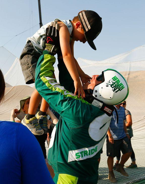 Skydiver Luke Aikins celebrates with son Logan after jumping 25,000 feet from an airplane without a parachute or wing suit as part of 'Stride Gum Presets Heaven Sent' on July 30, 2016 in Simi Valley, California.