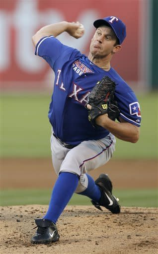 Texas Ranger's Roy Oswalt works against the Oakland Athletics in the first inning of a baseball game, Tuesday, July 17, 2012, in Oakland, Calif. (AP Photo/Ben Margot)