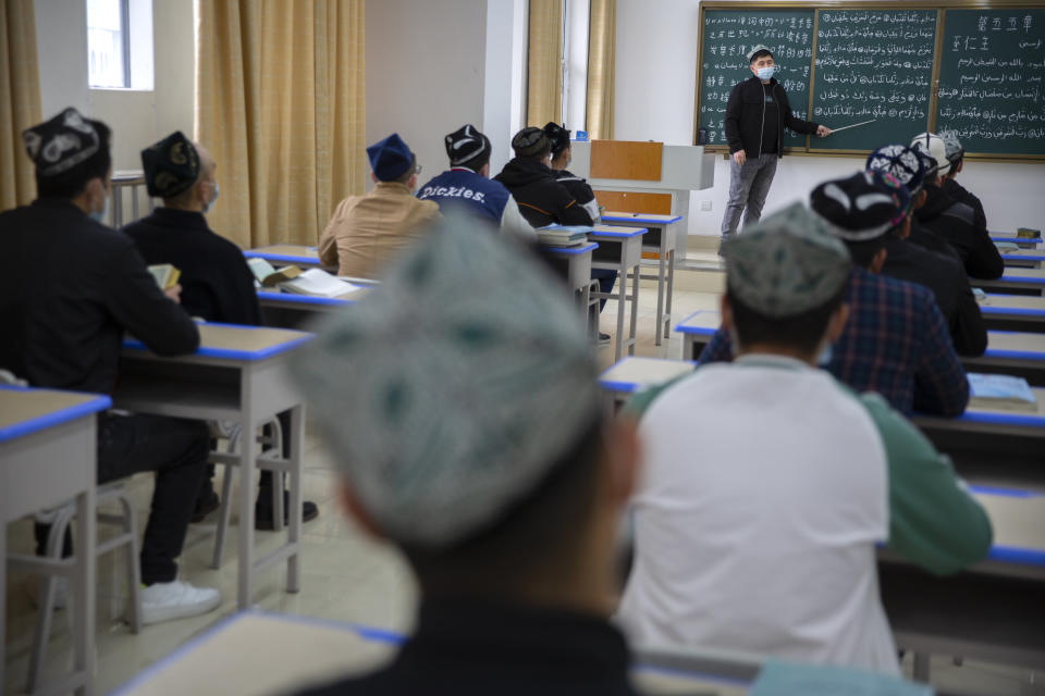 Students training to become imams recite verses from the Quran at the Xinjiang Islamic Institute in Urumqi, the capital of China's far west Xinjiang region, during a government organized visit for foreign journalists on April 21, 2021. Four years after Beijing's brutal crackdown on largely Muslim minorities native to Xinjiang, Chinese authorities are dialing back the region's high-tech police state and stepping up tourism. But even as a sense of normality returns, fear remains, hidden but pervasive. (AP Photo/Mark Schiefelbein)
