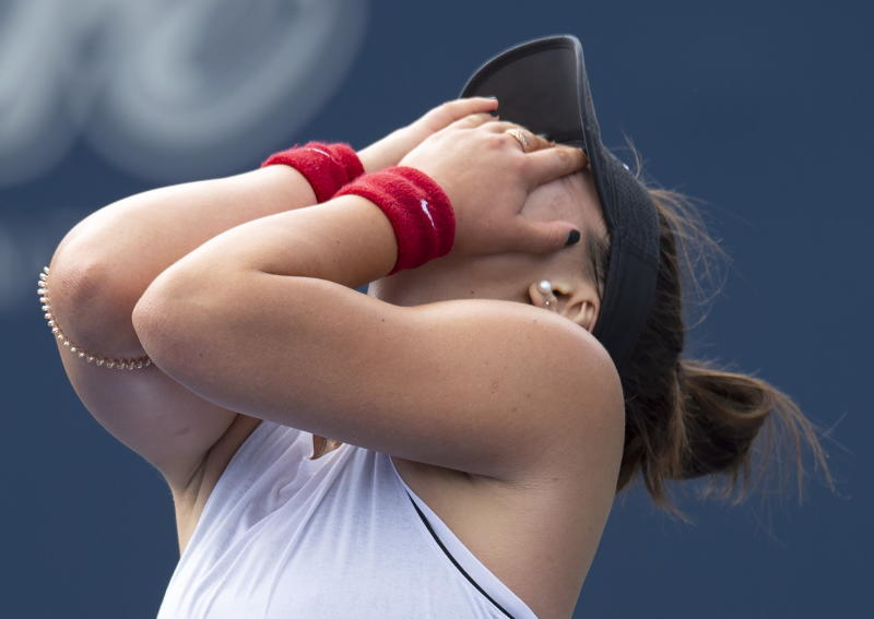 Bianca Andreescu, of Canada, celebrates after defeating Sofia Kenin, of the United States during the Rogers Cup women's tennis tournament Saturday, Aug. 10, 2019, in Toronto. (Frank Gunn/The Canadian Press via AP)