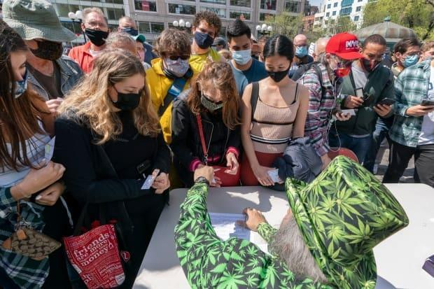 A 'Joints for Jabs' event in New York earlier this month, where adults who showed their COVID-19 vaccination cards received a free joint. Places around the U.S. are offering incentives to try to energize the nation's slowing vaccination drive and get reluctant Americans to roll up their sleeves.