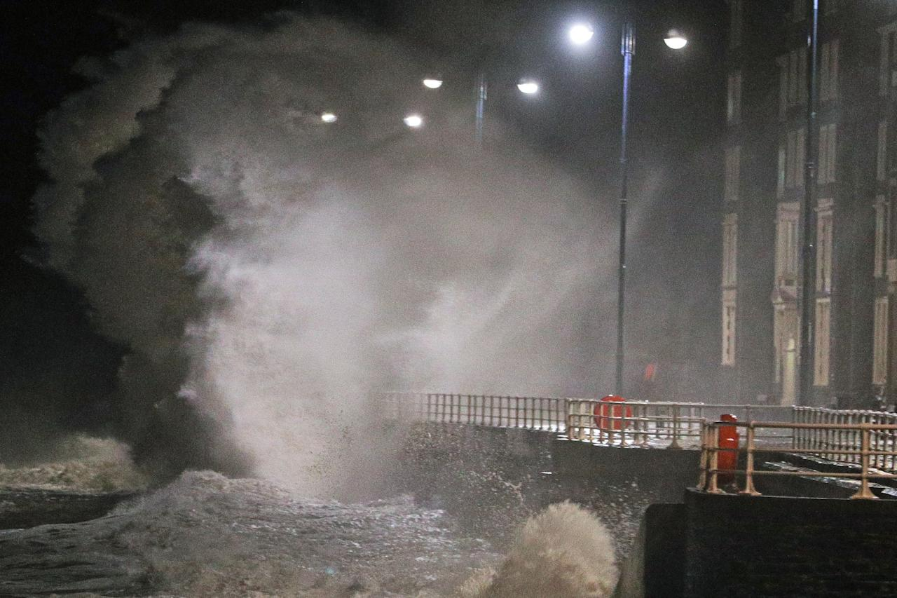 <p>Waves crash against the sea wall in Aberystwyth in west Wales as Storm Eleanor hits the UK causing power cuts and road disruption. (PA) </p>