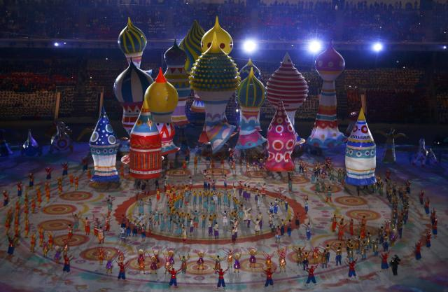 Performers dance near floats representing St. Basil's Cathedral during the opening ceremony of the 2014 Sochi Winter Olympics, February 7, 2014. REUTERS/David Gray (RUSSIA - Tags: OLYMPICS SPORT)
