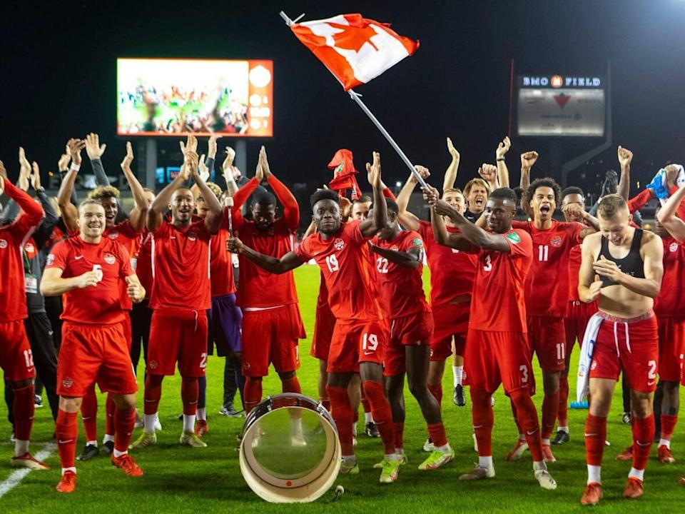 Alphonso Davies, centre, leads Canada's team in a victory celebration following a 4-1 win over Panama on Wednesday in Toronto. (Chris Young/The Canadian Press - image credit)