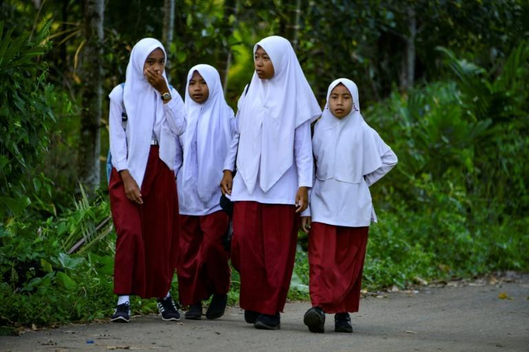 Schools across Indonesia have long used a combination of psychological pressure, public humiliation, and sanctions to persuade girls to wear hijab, HRW says